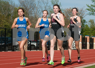photo by Sarah A. Miller/Tyler Morning Telegraph  Lindale's junior Sidney Hacker, senior Kayla Callaway and Whitehouse's freshman Abby Dahlgren and sophomore Kinley Holloway compete in the 800 meters race during the District 16-4A track meet at Lindale High School's Eagle Stadium Thursday.