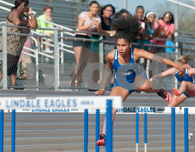 photo by Sarah A. Miller/Tyler Morning Telegraph  Lindale's senior Gracie Tucker takes the lead to win the 100 meter hurdles at the District 16-4A track meet at Lindale High School's Eagle Stadium.