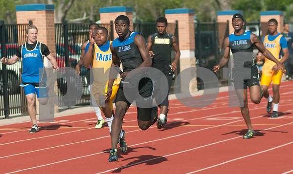 photo by Sarah A. Miller/Tyler Morning Telegraph  John Tyler's freshman Damion Miller, center, competes in the varsity sprint relays during the District 16-4A track meet at Lindale High School's Eagle Stadium Thursday.
