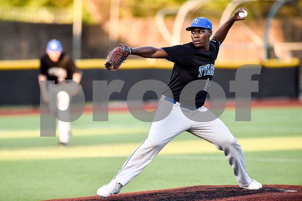 John Tyler's James Dews (14) pitches during a high school baseball game at Mike Carter Field in Tyler, Texas, on Tuesday, April 10, 2018. (Chelsea Purgahn/Tyler Morning Telegraph)