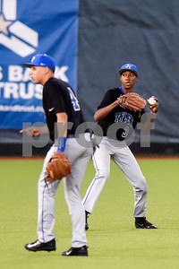 John Tyler's Pedro Martinez (4) turns around as teammate Jamari Cole (3) throws the ball during a high school baseball game at Mike Carter Field in Tyler, Texas, on Tuesday, April 10, 2018. (Chelsea Purgahn/Tyler Morning Telegraph)
