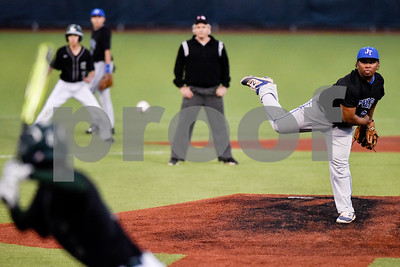 John Tyler's Andre Wilson (8) pitches during a high school baseball game at Mike Carter Field in Tyler, Texas, on Tuesday, April 10, 2018. (Chelsea Purgahn/Tyler Morning Telegraph)