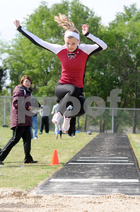 photo by Sarah A. Miller   Whitehouse's sophomore Kelly Keller competes in the women's long jump event at the District 16-4A track & field meet at Whitehouse Wildcat Stadium Thursday.