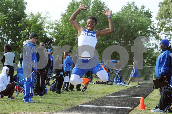 photo by Sarah A. Miller   John Tyler's freshman Bryston Gipson competes in the mens long jump event at the District 16-4A track & field meet at Whitehouse Wildcat Stadium Thursday.