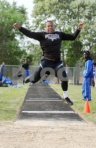 photo by Sarah A. Miller   Whitehouse's sophomore Dominique Hallie competes in the mens long jump event at the District 16-4A track & field meet at Whitehouse Wildcat Stadium Thursday.