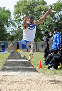 photo by Sarah A. Miller   John Tyler's senior Andre Jefferson makes a 22.6 jump in the mens varsity long jump event at the District 16-4A track & field meet at Whitehouse Wildcat Stadium Thursday.