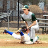 Leominster's Brett Corliss dives safely back to first as Drew Connelly applies the tag. 	SENTINEL & ENTERPRISE / SCOTT LAPRADE