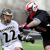 Monarch's Zach Capra (left) dodges Fairview's Zach Marriner (right) during their lacrosse game in Louisville, Colorado April 12, 2011.  CAMERA/Mark Leffingwell
