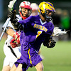 Boulder's Michael Simboski (right) gets around Fairview's Dakin Platt (left) during their lacrosse game at Fairview in Boulder, Colorado April 12, 2012. CAMERA/MARK LEFFINGWELL