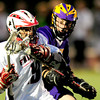 Boulder's Sam Hagar (right) blocks Fairview's Beau Scott (left) during their lacrosse game at Fairview in Boulder, Colorado April 12, 2012. CAMERA/MARK LEFFINGWELL