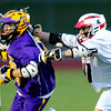 Fairview's Alex Brussell (right) shoves Boulder's Brandon Jacobs during their lacrosse game at Fairview in Boulder, Colorado April 12, 2012. CAMERA/MARK LEFFINGWELL