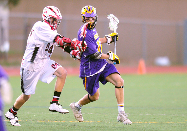 Fairview's Wesley Carothers (left) jams Boulder's Dylan Brooks (right) during their lacrosse game at Fairview in Boulder, Colorado April 12, 2012. CAMERA/MARK LEFFINGWELL