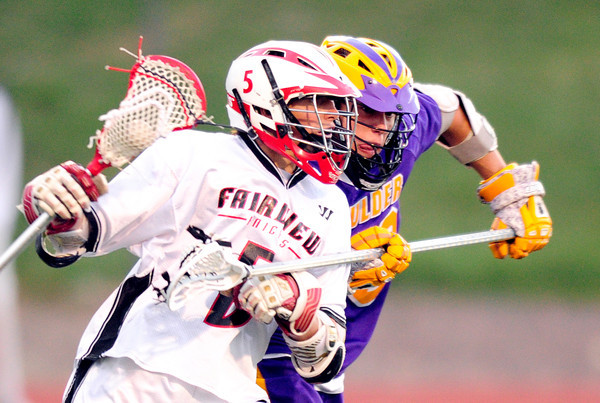 Fairview's Chris Robinson (left) tries to get past Boulder's Vito Leccese  (right) during their lacrosse game at Fairview in Boulder, Colorado April 12, 2012. CAMERA/MARK LEFFINGWELL