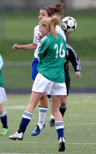 Centaurus' Shanlie Anderson (left) and Standley Lake's Andra Thaden (right) go for the ball during their soccer game at Centaurus High School in Louisville, Colorado April 13, 2012. CAMERA/MARK LEFFINGWELL