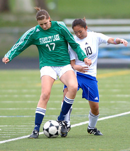 Centaurus' Allison Ebersole (right) and Standley Lake's Erin Cortvriendt (left) fight for the ball during their soccer game at Centaurus High School in Louisville, Colorado April 13, 2012. CAMERA/MARK LEFFINGWELL