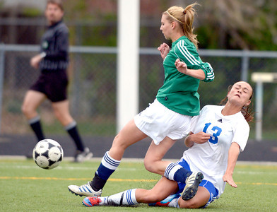 Centaurus' Midori Patterson (right) slide kicks the ball past Standley Lake's Andra Thaden (left) during their soccer game at Centaurus High School in Louisville, Colorado April 13, 2012. CAMERA/MARK LEFFINGWELL
