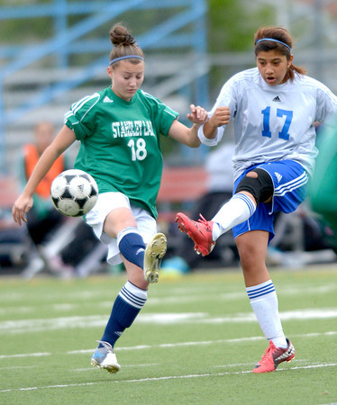 Centaurus' Rosa Solgado (right) and Standley Lake's Taylor Redding (left) go for the ball during their soccer game at Centaurus High School in Louisville, Colorado April 13, 2012. CAMERA/MARK LEFFINGWELL