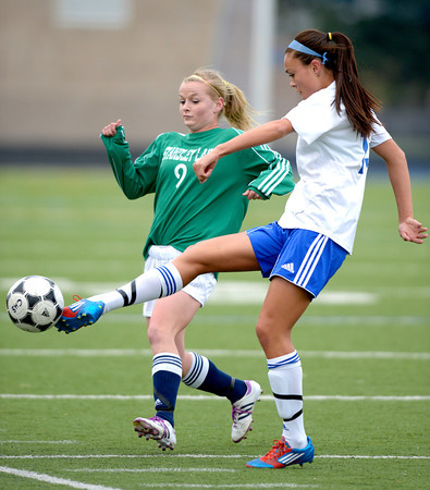 Centaurus' Midori Patterson (right) kicks the ball away from Standley Lake's Brianna Ashmore (left) during their soccer game at Centaurus High School in Louisville, Colorado April 13, 2012. CAMERA/MARK LEFFINGWELL