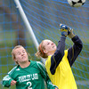 Centaurus' Kelly Turcotte (right) knocks a corner kick away from Standley Lake's Emily Ashmore (left) during their soccer game at Centaurus High School in Louisville, Colorado April 13, 2012. CAMERA/MARK LEFFINGWELL