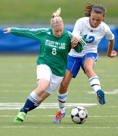 Centaurus' Midori Patterson (right) and Standley Lake's Ashley Tackman (left) fight for the ball during their soccer game at Centaurus High School in Louisville, Colorado April 13, 2012. CAMERA/MARK LEFFINGWELL