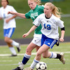 Centaurus' Morgan Brendefur (right) beats Standley Lake's Jordin Clark (left) to the ball during their soccer game at Centaurus High School in Louisville, Colorado April 13, 2012. CAMERA/MARK LEFFINGWELL