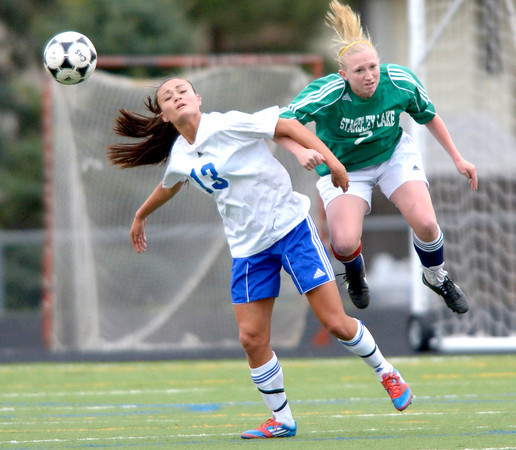 Centaurus' Midori Patterson (left) and Standley Lake's Jordin Clark (right) collide going for the ball during their soccer game at Centaurus High School in Louisville, Colorado April 13, 2012. CAMERA/MARK LEFFINGWELL