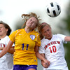 Fairview's Olivia Fear (left) and Nikola Machalek (right) collide with Boulder's Erin Stenhouse (middle) during their soccer game at Fairview High School in Boulder, Colorado April 17, 2012. CAMERA/MARK LEFFINGWELL