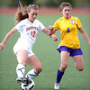 Fairview's Daphnee Morency (left) is pressured by Boulder's Dani Davis (right) during their soccer game at Fairview High School in Boulder, Colorado April 17, 2012. CAMERA/MARK LEFFINGWELL