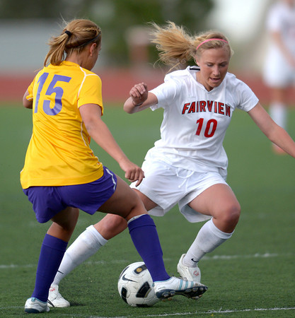 Fairview's Nikola Machalek (right) and Boulder's Zoe Dulchinos (left) go for the ball during their soccer game at Fairview High School in Boulder, Colorado April 17, 2012. CAMERA/MARK LEFFINGWELL