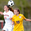 Fairview's Kenzie Whitcomb (left) and Boulder's Sarah Pykkonen (right) bump going for the ball `during their soccer game at Fairview High School in Boulder, Colorado April 17, 2012. CAMERA/MARK LEFFINGWELL