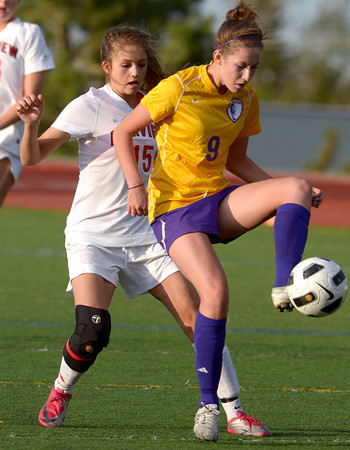 Boulder's Kate Glynn (right) tries the keep the ball from Fairview's Pyrenee Steiner (left) during their soccer game at Fairview High School in Boulder, Colorado April 17, 2012. CAMERA/MARK LEFFINGWELL