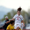 Fairview's Issi Stahl (right) heads the ball over Boulder's Dani Davis (left) during their soccer game at Fairview High School in Boulder, Colorado April 17, 2012. CAMERA/MARK LEFFINGWELL