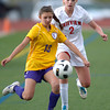 Boulder's Sarah Radzihovsky (left) kicks the ball away from Fairview's Gaelyn Crowder (right) during their soccer game at Fairview High School in Boulder, Colorado April 17, 2012. CAMERA/MARK LEFFINGWELL