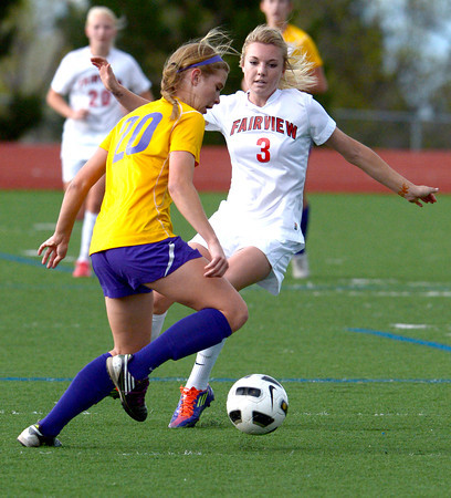 Fairview's Reci Smith (right) pressures Boulder's Abby Burridge (left) during their soccer game at Fairview High School in Boulder, Colorado April 17, 2012. CAMERA/MARK LEFFINGWELL