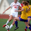 Fairview's Lillian Bitner (left) kicks the ball away from Boulder's Kylee Worthington (right) during their soccer game at Fairview High School in Boulder, Colorado April 17, 2012. CAMERA/MARK LEFFINGWELL