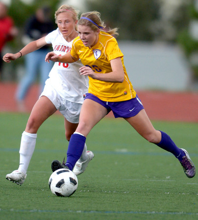 Fairview's Nikola Machalek (left) and Boulder's Abby Burridge race for the ball during their soccer game at Fairview High School in Boulder, Colorado April 17, 2012. CAMERA/MARK LEFFINGWELL
