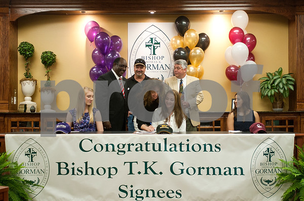 photo by Sarah A. Miller   Bishop Thomas K. Gorman Regional Catholic School athletes Susannah Williams, Kimberla Prevost and Aubrey Miller sign letters of intent Wednesday to play collegiate sports.