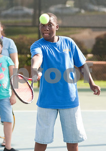photo by Sarah A. Miller   Tyler Boys & Girls Club member Colby Jones, 12, practices hitting a tennis ball Tuesday during the first day of the new Tyler First Aces program at Tyler Junior College's JoAnn Medlock Murphy Tennis Center. The program pairs children with TJC and University of Texas at Tyler tennis team players so they can learn to play the game.