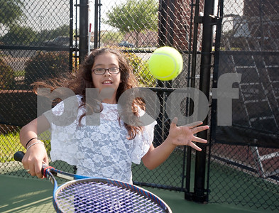photo by Sarah A. Miller   Tyler Boys & Girls Club member Brianna Rincon, 11, practices controlling a tennis ball Tuesday during the first day of the new Tyler First Aces program at Tyler Junior College's JoAnn Medlock Murphy Tennis Center. The program pairs children with TJC and University of Texas at Tyler tennis team players so they can learn to play the game.
