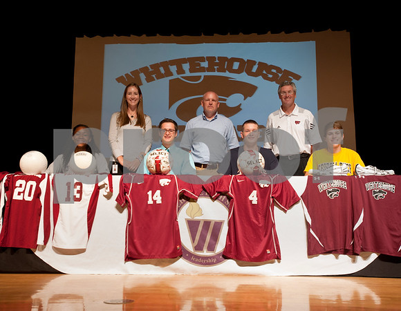 photo by Sarah A. Miller   Whitehouse High School athletes Fullani Petties, Destin Wilkins, Andrew Stevenson and Troy Hayden signed letters of intent to play on the collegiate level Wednesday at school.
