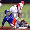 North Mesquite's Chris Garza (22) runs back to first base as Robert E. Lee's Matt Hittle (21) attempts to tag him out during a high school baseball game at Mike Carter Field in Tyler, Texas on Tuesday, April 17, 2018.  (Chelsea Purgahn/Tyler Morning Telegraph)