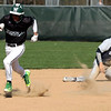 Westlake's Adam Dixon runs to third after the ball gets by Lorain shortstop Ray Rodriguez. Randy Meyers -- The Morning Journal