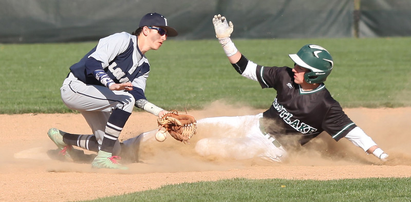 Westlake's Dylan Cole slides into second safely as Lorain infielder Blake Bartlome can't hold on to the ball. Randy Meyers -- The Morning Journal