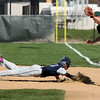 Lorain's Manny Brown dives back to first safely as Luke Platsburger of Westlake looks to tag him. Randy Meyers -- The Morning Journal