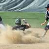 Westlake's Conner Sterneckert slides into second safely in a cloud of dust as Lorain's Ray Rodriguez and Javier Caraballo lose the ball. Randy Meyers -- The Morning Journal