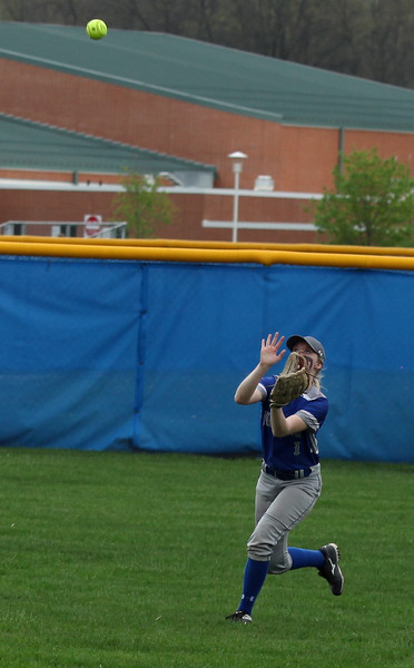 Midview right fielder Angela O'Connor catches a fly ball against Amherst. Randy Meyers -- The Morning Journal