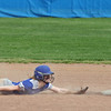 Amherst infielder Jessica Pihlblad is pulled off of second base by the throw and Sara Liszeski dives back safely. Randy Meyers -- The Morning Journal