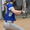 Midview's Sara Liszeski delivers a double and drives in a run against Amherst. Randy Meyers -- The Morning Journal