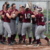 Rocky River's Maureen Cain is congratulated by her teammates after hitting a home run against Elyria Catholic. Randy Meyers -- The Morning Journal