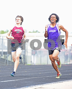 Whitehouse senior Jonathan Scott and Lufkin senior Drew Jackson compete in the 800 meter run Thursday at the 15/16-5A Track and Field Championships held in Whitehouse Thursday April 21, 2016.  (Sarah A. Miller/Tyler Morning Telegraph)
